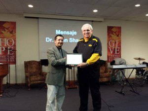 Associational Missionary John Shaull presents a certificate to Pastor Arnaldo Achucarro recognizing Cristo Vive as a constituted church body.
