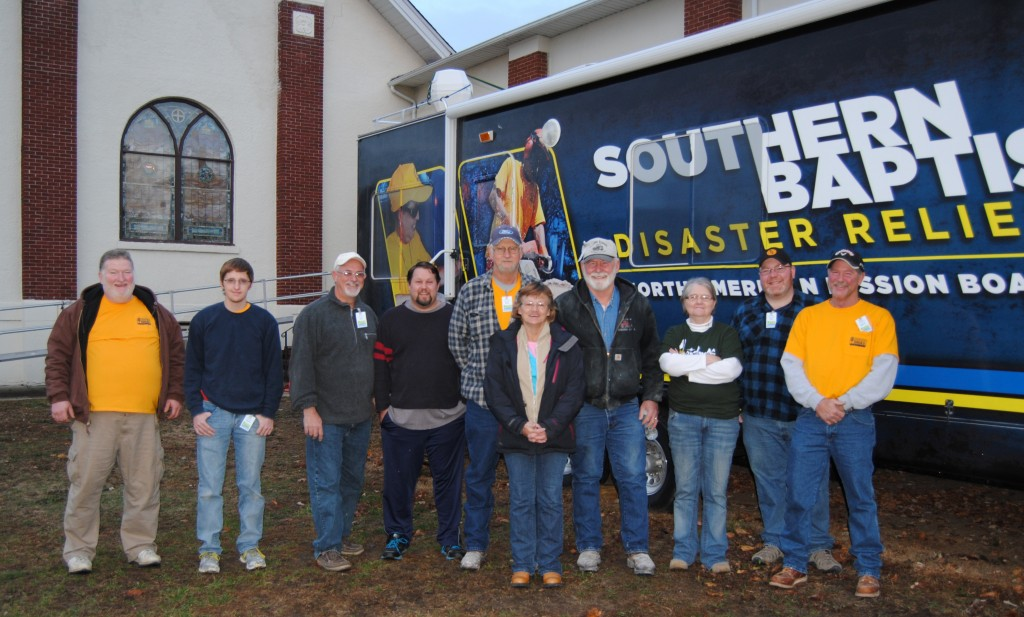 """Members of the Disaster Relief Hurricane Sandy Rebuild Team included (left to right) Wes Wehage, Tanner Doolin, Dan Doolin, George Lensgraft, Dave Wieling, Nancy Hodges, Gene """"Cowboy"""" Helmig, Pam Johnston, Thad """"Red"""" Helmig, Marvin Bedding."""
