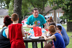 Lazybrook Baptist Church pastor John Neesley shares the gospel with participants at a block party the church hosted as part of Crossover Houston in 2013. Service evangelism is the heart of the 2014 emphasis for God's Plan for Sharing, a ministry supported by the Evangelism Networks/Resources area of the North American Mission Board's evangelism group. NAMB photo by Susan Whitley