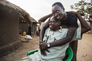 Pastor Tolbert Alochi is embraced by a young man who received help at Faith Baptist Church in Nimule, South Sudan.  IMB photo by JoAnn Bradberry.