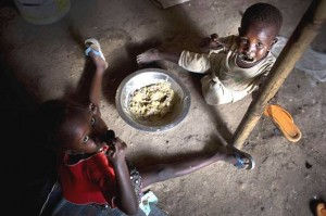 Children displaced by recent fighting eat their daily meal at a displacement site on the Tomping base of the United Nations peacekeeping mission in South Sudan (UNMISS) in the capital city of Juba.  Photo © UNICEF/NYHQ2014-0344/Holt, used with permission.