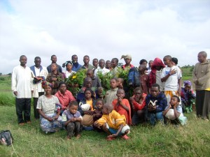 Pastor Alobo (far left) and his congregation at Dzaleka.