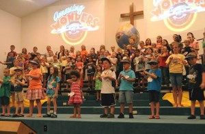 "Children at Vacation Bible School present their ""Family Night"" program on the Friday night of VBS week, which drew 100 youngsters this year and 74 adult and youth leaders.  Photo by Karen Quinn."