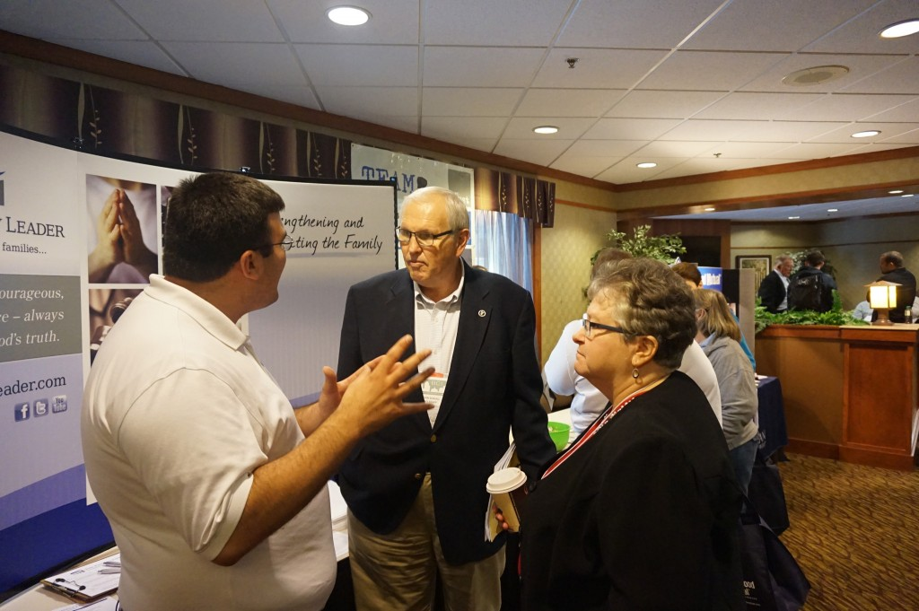 John and Sharon Shaul talk to a representative from Family Leader.