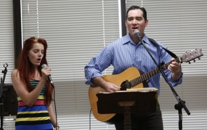 "Michael Johnson and his oldest daughter, Olivia, 15, lead the group in singing, ""Burning in my Soul"" at the beginning of the River Church meeting in the Community Room in Moxee City Hall in Moxee, Wash. on Oct. 19, 2014. (KAITLYN BERNAUER)"