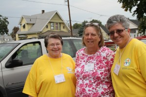 Missionfest volunteers Helen Henley, Mary Allen and Rosann Lafata prayerwalk and invite area residents to Hope of Glory Church.