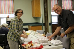 Jeff Woolum, pastor of First Baptist Church, Perrysburg, Ohio, and wife Karen prepare a meal for Missionfest volunteers.