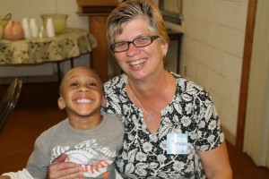 Teresa Bailey, WMU director for the Northwest Ohio Baptist Association, meets a new little friend during Missionsfest.