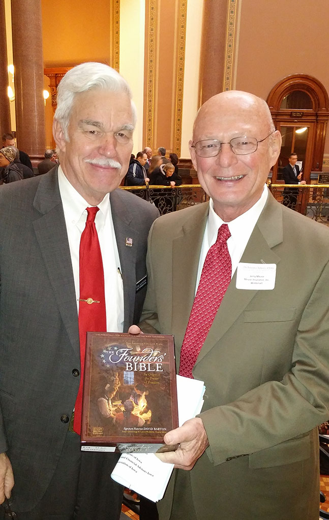 Jerry Mease, from New Bridge Church in Winterset,  presenting a Bible to State Representative Stan Gustafson.