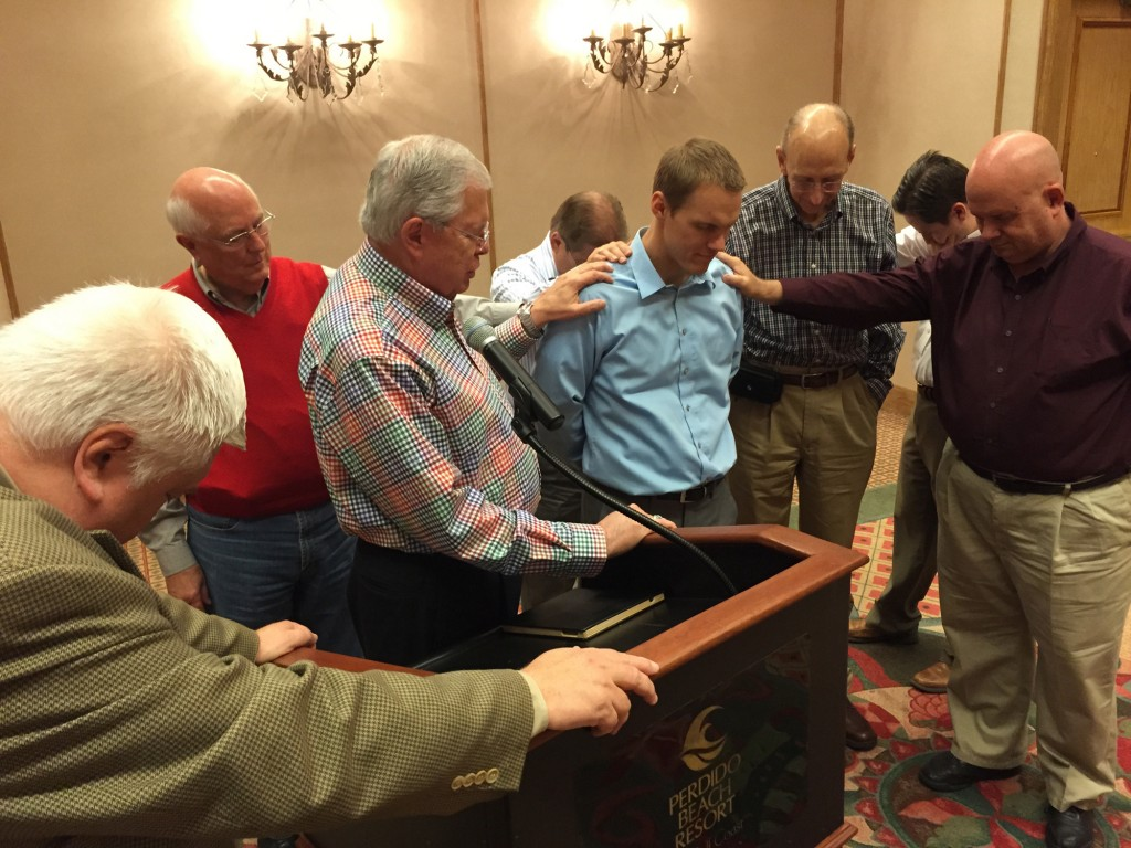 Baptist state executives and editors from around the country surround and pray for David Platt, newly elected president of the International Mission Board. Platt had shared with the group his five desires for the IMB during his time at the helm. Photo by Van Payne/IMB
