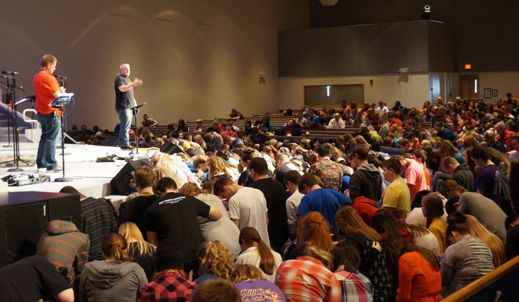 Jonathan Meyer and Jason Epperson,  the Next Gen teaching pastor at Southeast Christian Church in Louisville KY pray over students who are preparing to return to their schools and lead others to Christ.