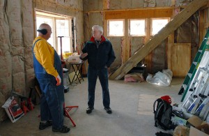 Robert Puttoff (left) talks with homeowner Jim Clark in Long Beach, N.Y. Southern Baptist Disaster Relief teams put in insulation and sheetrock in Clark's home during March 2015. NAMB photo by Laura Sikes