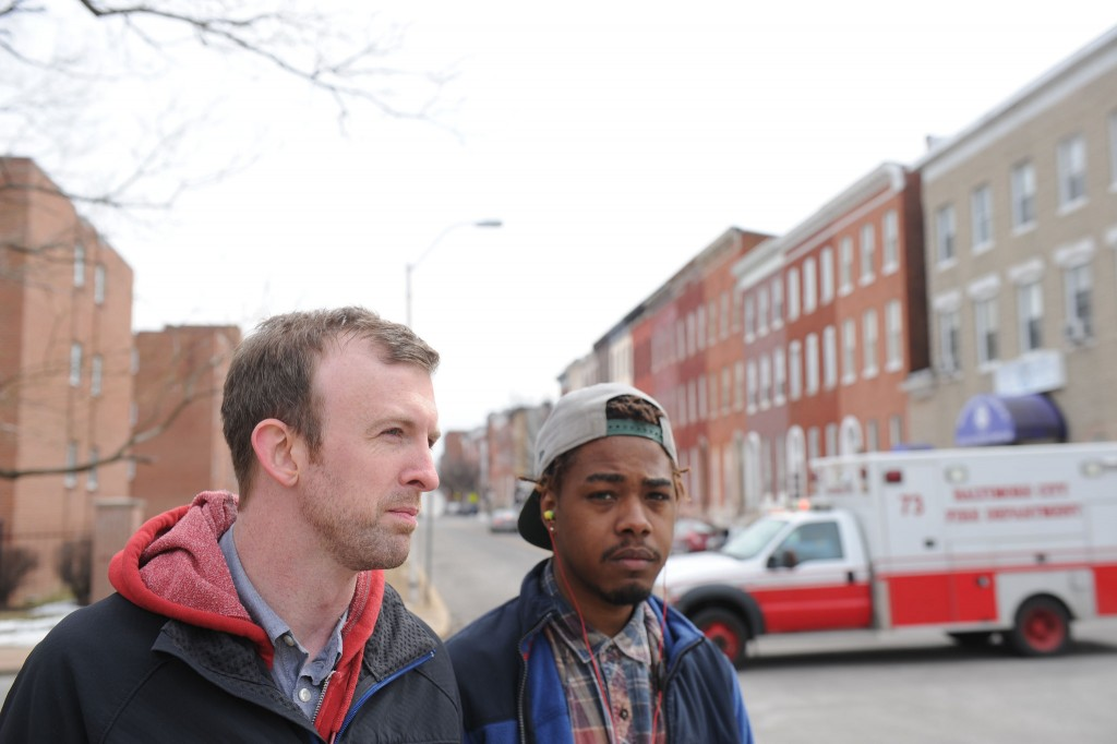 Joel Kurz (left), pastor of The Garden Church in Baltimore, spends time with church member and former drug dealer, King Thomas, who came to faith in Christ. Thomas is now a part of the church. Kurz is leading church efforts to assist in the clean up and ministry to their neighbors following a night of looting and rioting in the city April 27. NAMB file photo by Colby Ware