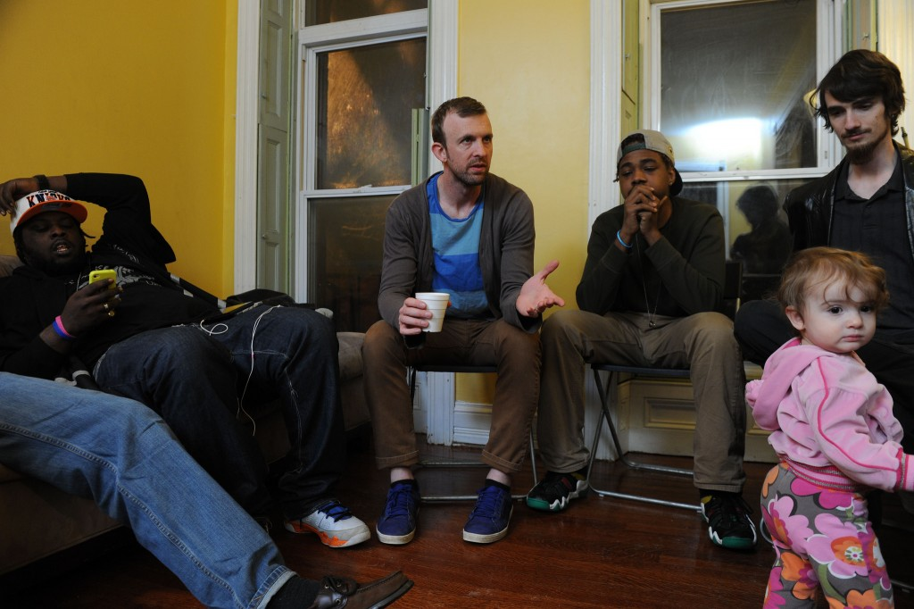 Pastor Joel Kurz (center) prepares to lead a Bible study in his home with members of The Garden Church. Kurz and members of the church are volunteering to help serve their neighbors in the aftermath of the April 27 riots in their city. NAMB file photo by Colby Ware