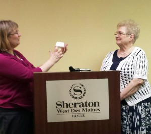 Joni Wilkinson recognizing Wilma Faulkner for her four years of service to Iowa WMU.