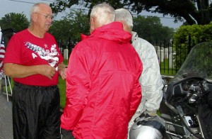 Sonny Roy (left) gives instructions to volunteers at the Ernest Roy Sr. Memorial Day Flag Relay in Mobile, Ala., held in memory of the father he never knew who was killed in combat during World War II. Photo courtesy Sonny Roy