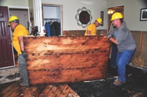 James King (left), Richard Brown and David Matlock, disaster relief volunteers with the Baptist General Convention of Oklahoma, remove floorboards and sheetrock from one of many flooded homes throughout the state. Oklahoma and Texas have been deluged with record rainfall in recent weeks, resulting in historic flooding. Photo courtesy Baptist General Convention of Oklahoma Disaster Relief