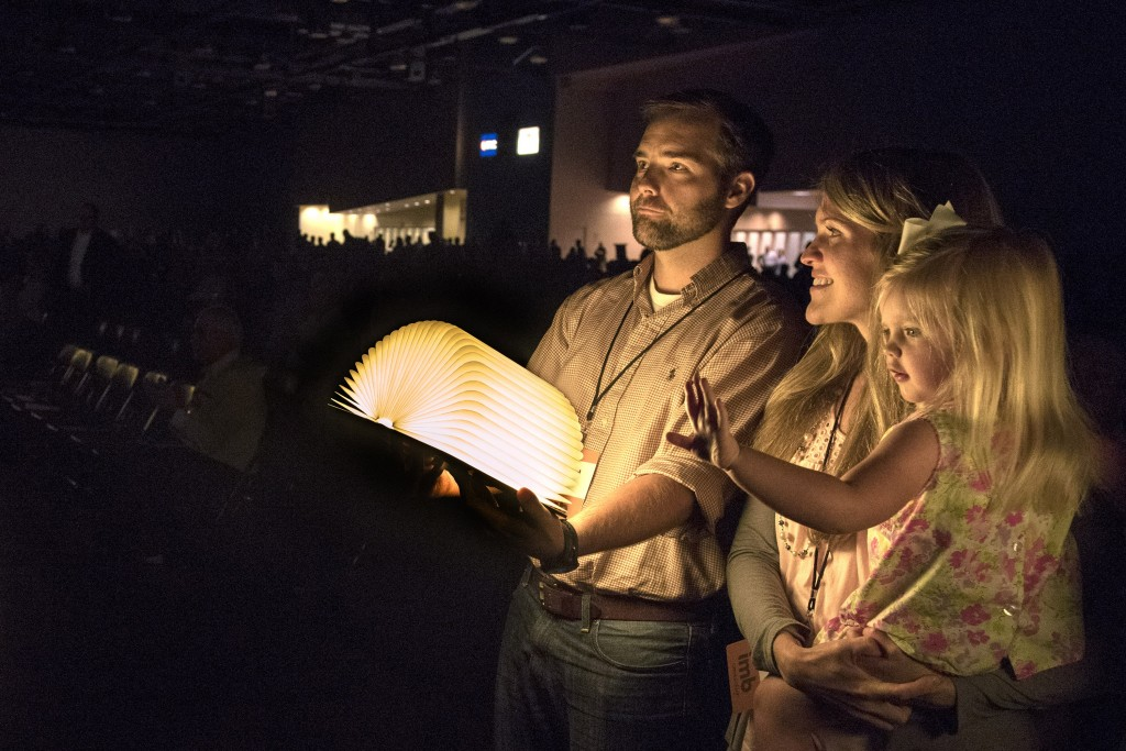 David and Katie Kizziah and their daughter Karis, hold a book that lights up when opened during the morning session June 17 at the Greater Columbus Convention Center in Columbus, Ohio. At the end of the Church and Mission Sending Celebration by the International Mission Board and the North American Mission Board, each missionary stood up and opened their book. Photo by Paul W. Lee/IMB