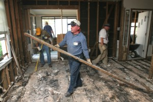 Southern Baptist Disaster Relief volunteers clear debris from a home in Pascagoula Miss., flooded by Hurricane Katrina. Destruction and damage from the storm spread 90,000 square miles and destroyed or made uninhabitable 300,000 homes. File photo by John Swain/NAMB