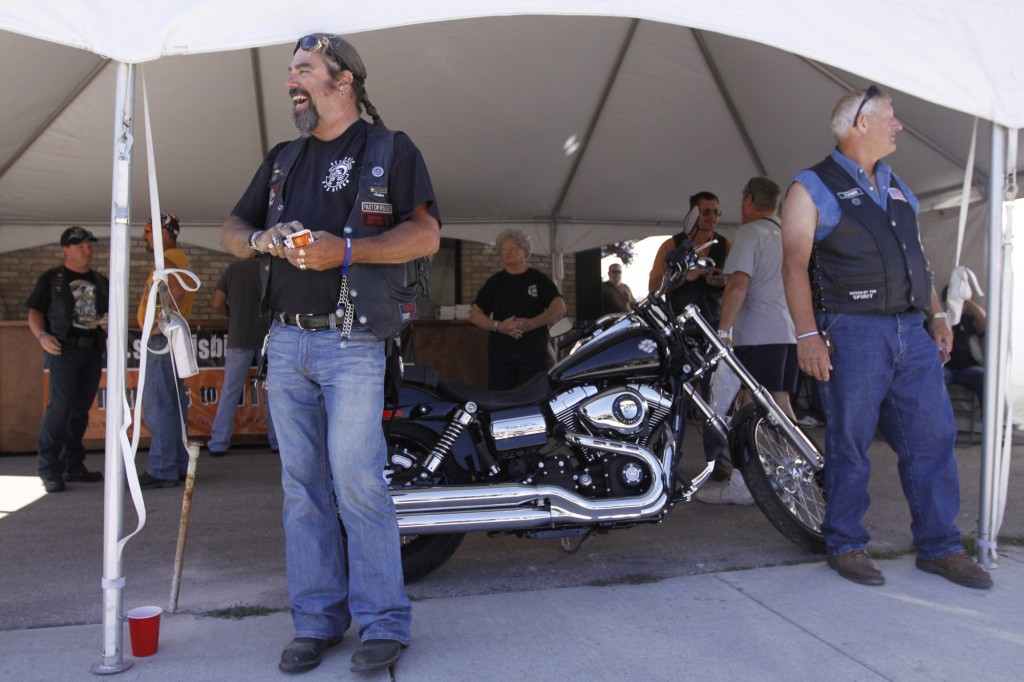 Baptist volunteers Roger Persing and Lyn Hanson work to draw passersby into a hospitality tent at the Sturgis Motorcycle Rally in 2010 where they heard testimony of God's power to change people. BP file photo