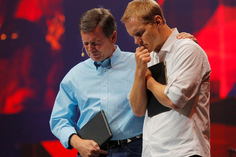 North American Mission Board President Kevin Ezell (left) and International Mission Board President David Platt pray to open the 2015 Send North America Conference where more than 13,000 participants gathered to discover mission opportunities. Photo by John Swain/NAMB
