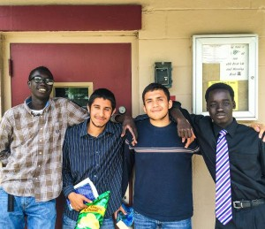 Leeh, Jose, Eric and Buop (L to R) relax after a work day at the Friendship Baptist Center
