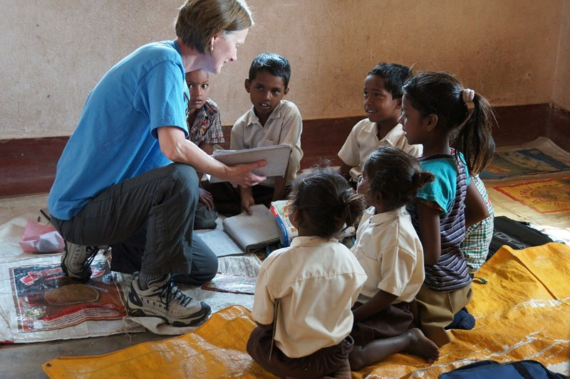 A missions-centered church reaches out to internationals living in the United States and in other countries, like this Arkansas woman teaching South Asian children.
