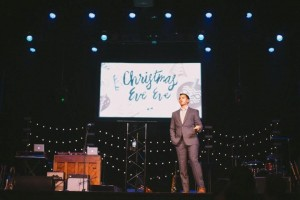 "Church planter Boyd Bettis, shown here preaching at last year's ""Christmas Eve Eve"" service, plans to ask attendees this year to think about ""what could be."" The inaugural Dec. 23 service drew an estimated 1,100 people to the historic Florida Theatre in downtown Jacksonville."