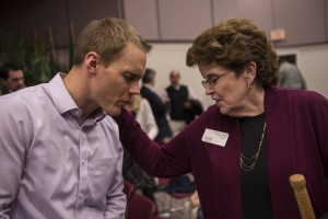 IMB trustee Audrey Smith (right) from the Northwest pauses to pray for IMB President David Platt following the missionary appointment service Feb. 23 in Richmond. The service celebrated 26 new missionaries who will be sent out to share the gospel around the world. (IMB Photo by Warren F. Johnson)