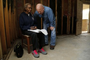 Dezzie Jackson, a 45-year resident at her home on Woods Street in Minden, La., asks for prayer with Gevan Spinney, pastor of First Baptist Church Haughton, La., after she received a phone call telling her that her vehicle was a total loss due to flood damage. NAMB photo by Stewart F. House